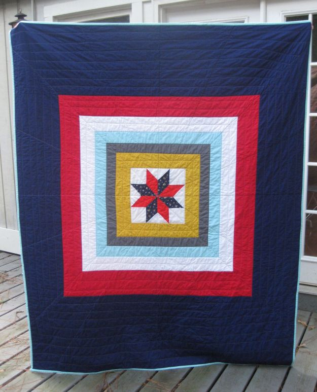 I made this quilt for 100 Quilts for Kids. The center star is surrounded in simple solid frames.